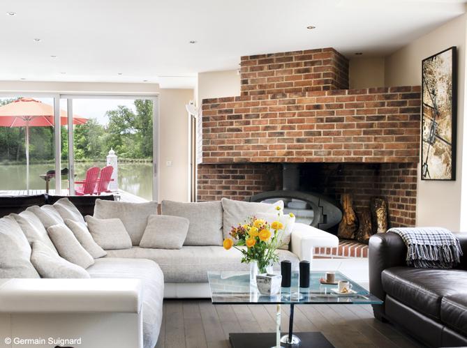 Nos 50 plus belles chemin es elle d coration for Construire cheminee foyer ouvert