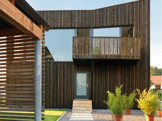 Les avantages d 39 un bardage en bois elle d coration for Porche de maison en bois